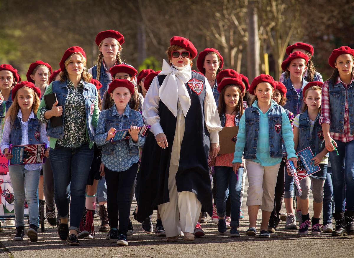 """This image released by Universal Studios shows Kristen Bell, front row second from left, and Melissa McCarthy, center, in a scene from, """"The Boss."""" (Hopper Stone/Universal Studios via AP)"""