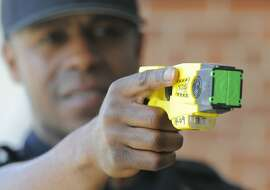 Patrolman Willie Guilford of the Stamford Police Department points a Taser X26 Stun Gun on April 1, 2016. Blacks and Hispanics are shot with stun guns more often in Connecticut, while whites are given the benefit of a warning far more often, a Hearst review of state data from 2015 shows. Stamford police, however, only shot three people with a stun gun last year.