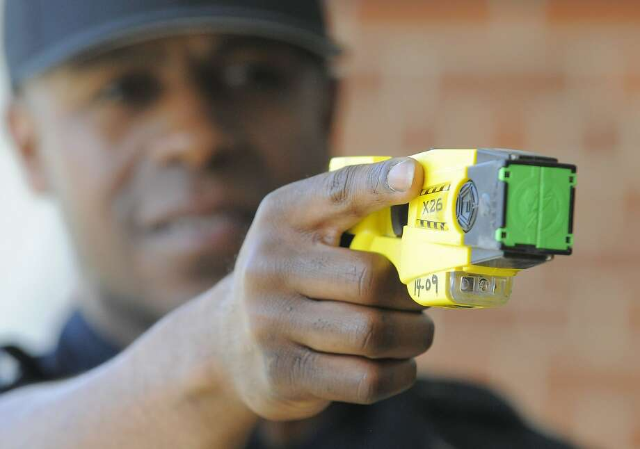 Patrolman Willie Guilford of the Stamford Police Department points a Taser X26 Stun Gun on April 1, 2016. Blacks and Hispanics are shot with stun guns more often in Connecticut, while whites are given the benefit of a warning far more often, a Hearst review of state data from 2015 shows. Stamford police, however, only shot three people with a stun gun last year. Photo: Matthew Brown, Hearst Connecticut Media