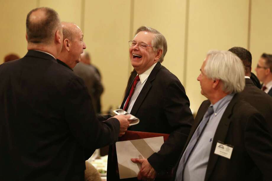 Stamford Mayor David Martin laughs with members of the city's Chamber of Commerce before the annual State of the City address held at the Hilton Hotel & Executive Meeting Center on Thursday, April 7, 2016. Photo: Michael Cummo / Hearst Connecticut Media / Stamford Advocate