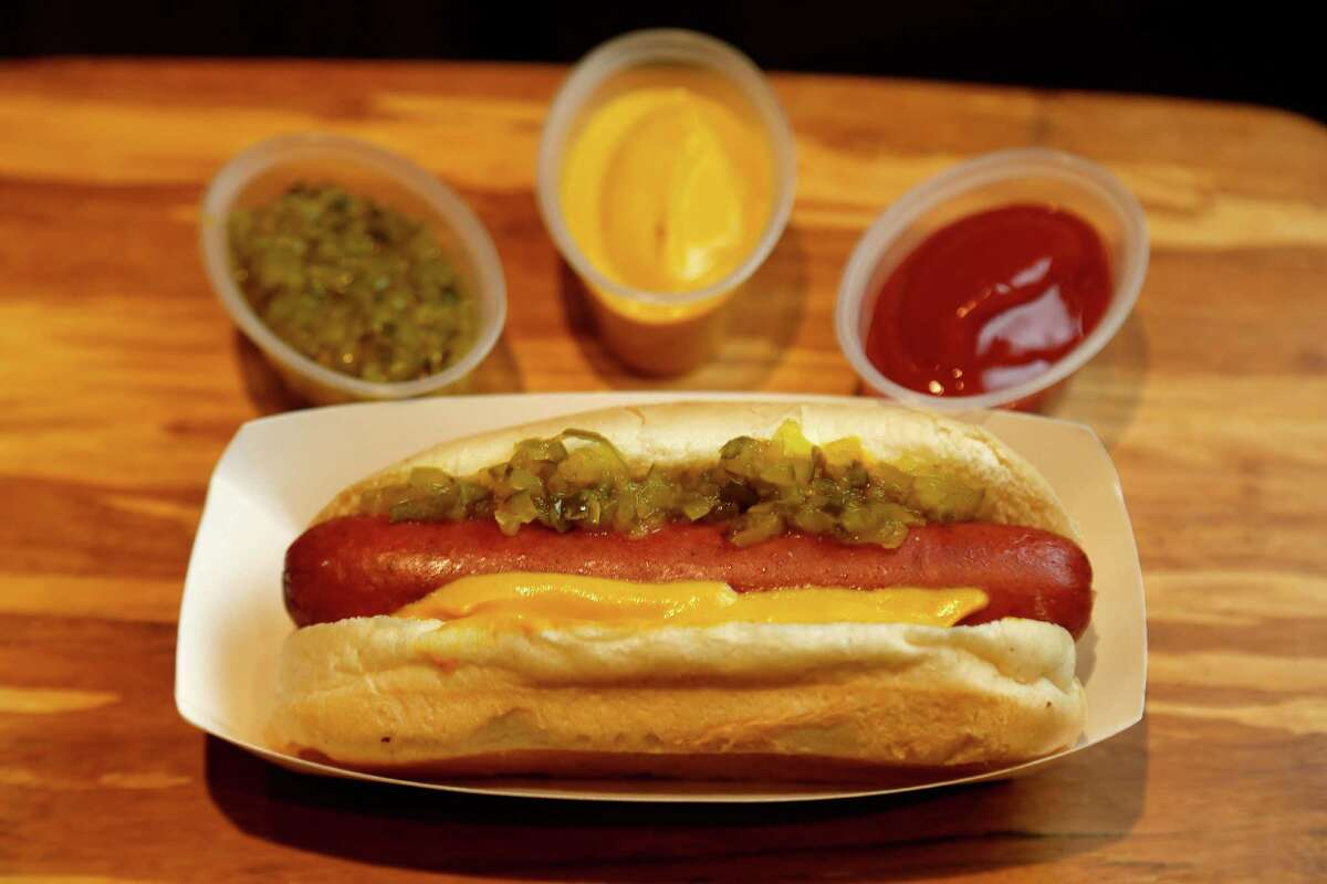 Nolan Ryan Jalapeno Cheese Dog: A Nolan Ryan Beef hot dog filled with cheese and jalapenos, served with ketchup, yellow mustard and relish.