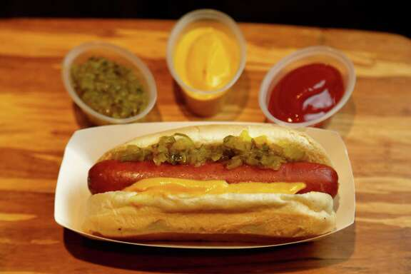Nolan Ryan Jalapeé±o Cheese Dog: A Nolan Ryan Beef hot dog filled with cheese and jalapeé±os, served with ketchup, yellow mustard and relish