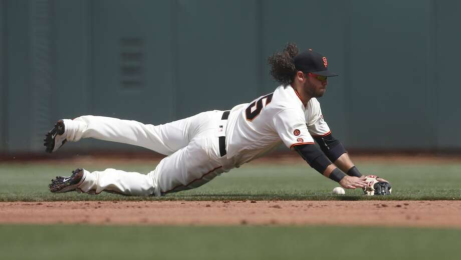 San Francisco Giants shortstop Brandon Crawford stops a ball but is unable to get  the out on a ground ball hit by the Los Angeles Dodgers' Joc Pederson during the second inning of the home opening day game on Thursday, April 7, 2016 in San Francisco, Calif. Photo: Beck Diefenbach, Special To The Chronicle