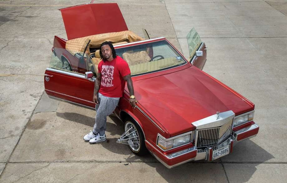 Chris Lockett is poised to drive his slab, a custom Cadillac Eldorado, in Saturday's Art Car Parade. Photo: Jon Shapley, Staff / © 2015  Houston Chronicle
