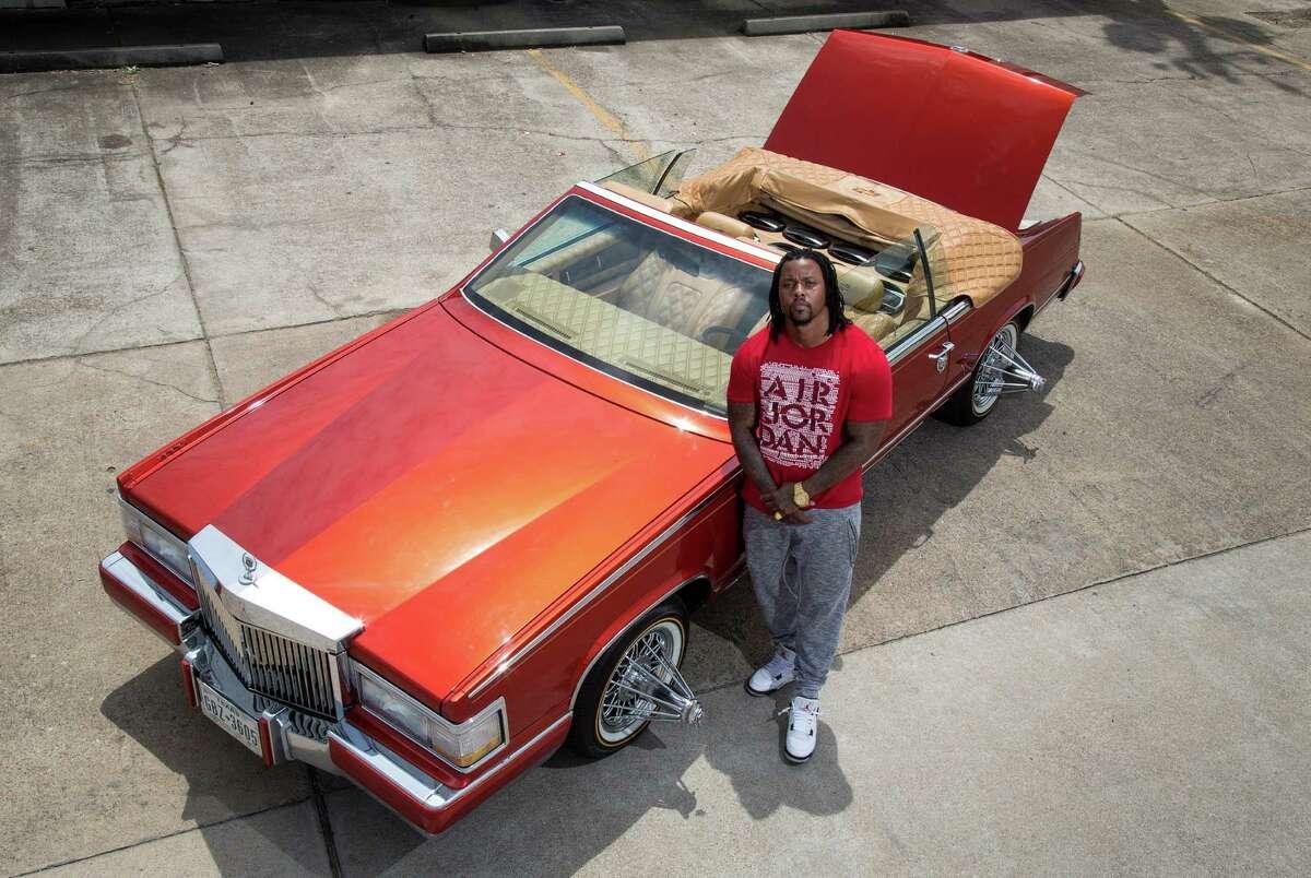 Chris Lockett poses for a portrait with his custom Cadillac Eldorado, in Houston.