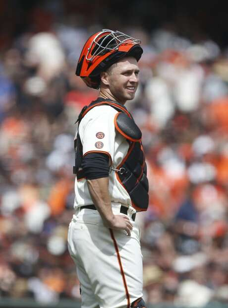 San Francisco Giants catcher Buster Posey watches as umpires deliberate a double play call during the second inning of the home opening day game against the Los Angeles Dodgers on Thursday, April 7, 2016 in San Francisco, Calif. Photo: Beck Diefenbach, Special To The Chronicle