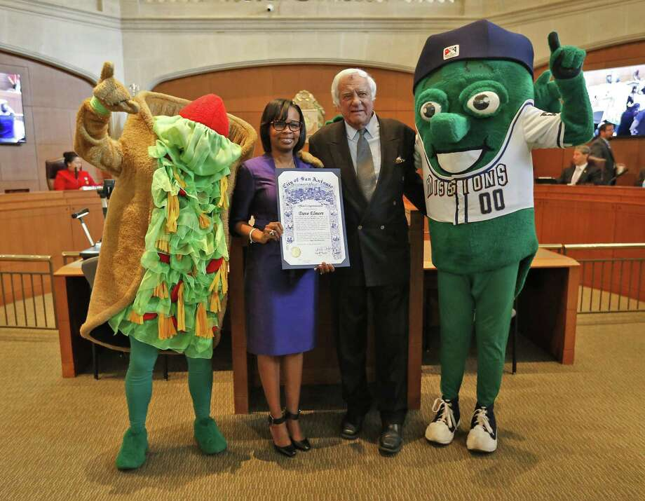 San Antonio Missions owner David Elmore (second from right) and Mayor Ivy Taylor — along with mascots The Puffy Taco (far left) and the Missions Ballapeno (far right) — pose for a photo as Taylor and Elmore announce at a City Council meeting that Triple-A baseball is headed to San Antonio for the 2019 season. Photo: Kin Man Hui /San Antonio Express-News / ©2016 San Antonio Express-News
