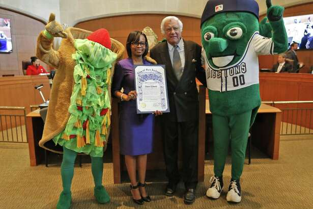 San Antonio Missions owner David Elmore and Mayor Ivy Taylor along with mascots: The Puffy Taco (far left) and the Missions Ballapeno (far right) pose as Taylor and Elmore announce that Triple-A baseball is headed to San Antonio. A study on the possibility of having baseball downtown as been kept under wraps.