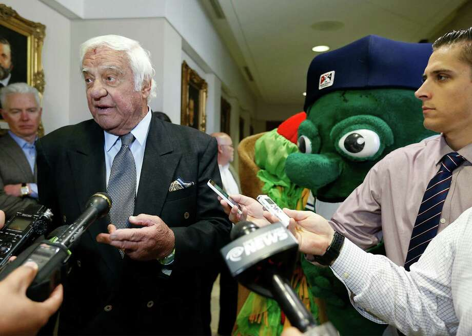 San Antonio Missions owner David Elmore (left) speaks to the media after the city and Elmore announce at a City Council meeting that Triple-A baseball is headed to San Antonio for the 2019 season. The city's recently released market study identified seven potential stadium sites in downtown.  Photo: Kin Man Hui /San Antonio Express-News / ©2016 San Antonio Express-News
