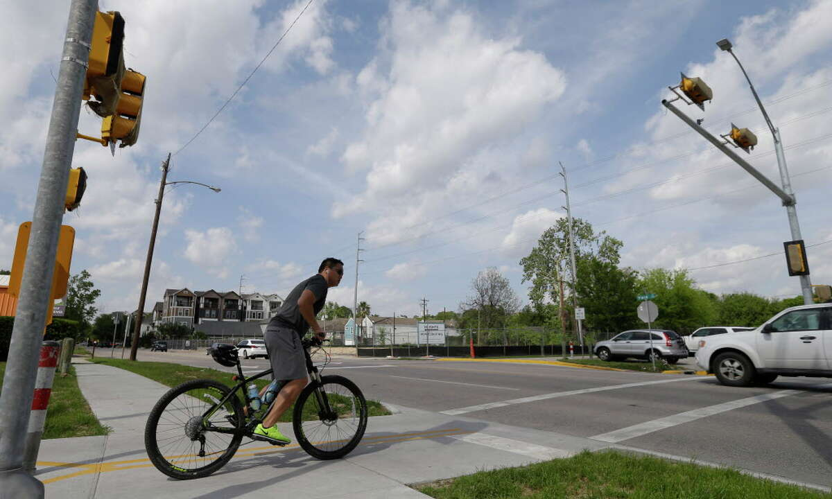 A bicylcist looks to cross Yale at the insection of the hike and bike trail and 7th on April 6, 2016, in Houston. A four-way traffic light has been installed but is not operational yet to give cyclists and joggers a safer crossing.