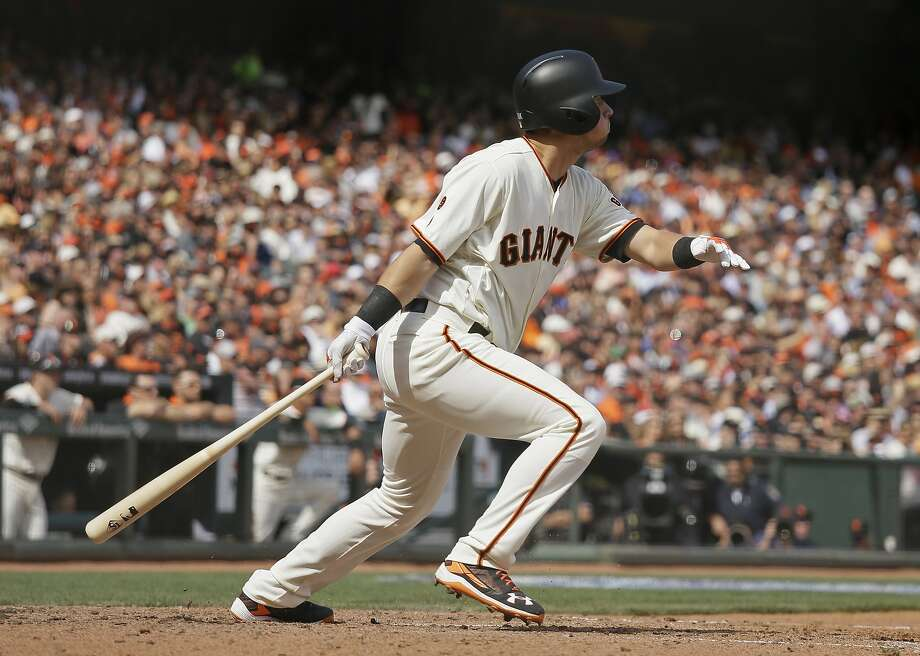 San Francisco Giants' Joe Panik hits an RBI-triple off Los Angeles Dodgers starting pitcher Alex Wood in the fifth inning of their baseball game Thursday, April 7, 2016, in San Francisco. (AP Photo/Eric Risberg) Photo: Eric Risberg, AP