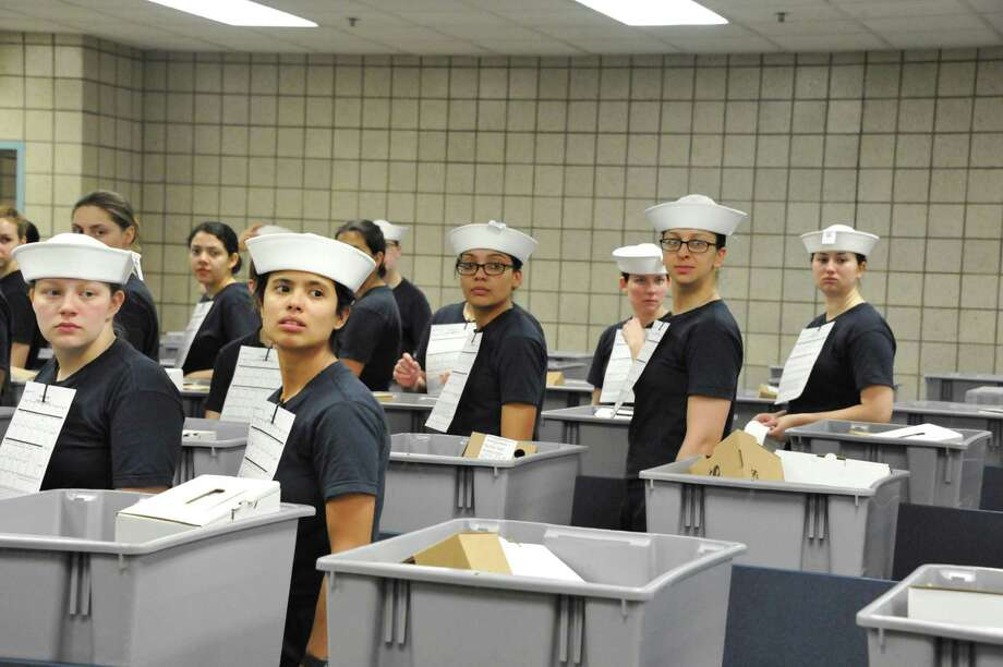 """Navy recruits receive their white enlisted hats Monday at Recruit Training Command in Illinois. Until this year, only men wore the hats, called """"Dixie cups.""""   Photo: SUE KRAWCZYK, HO / US NAVY"""