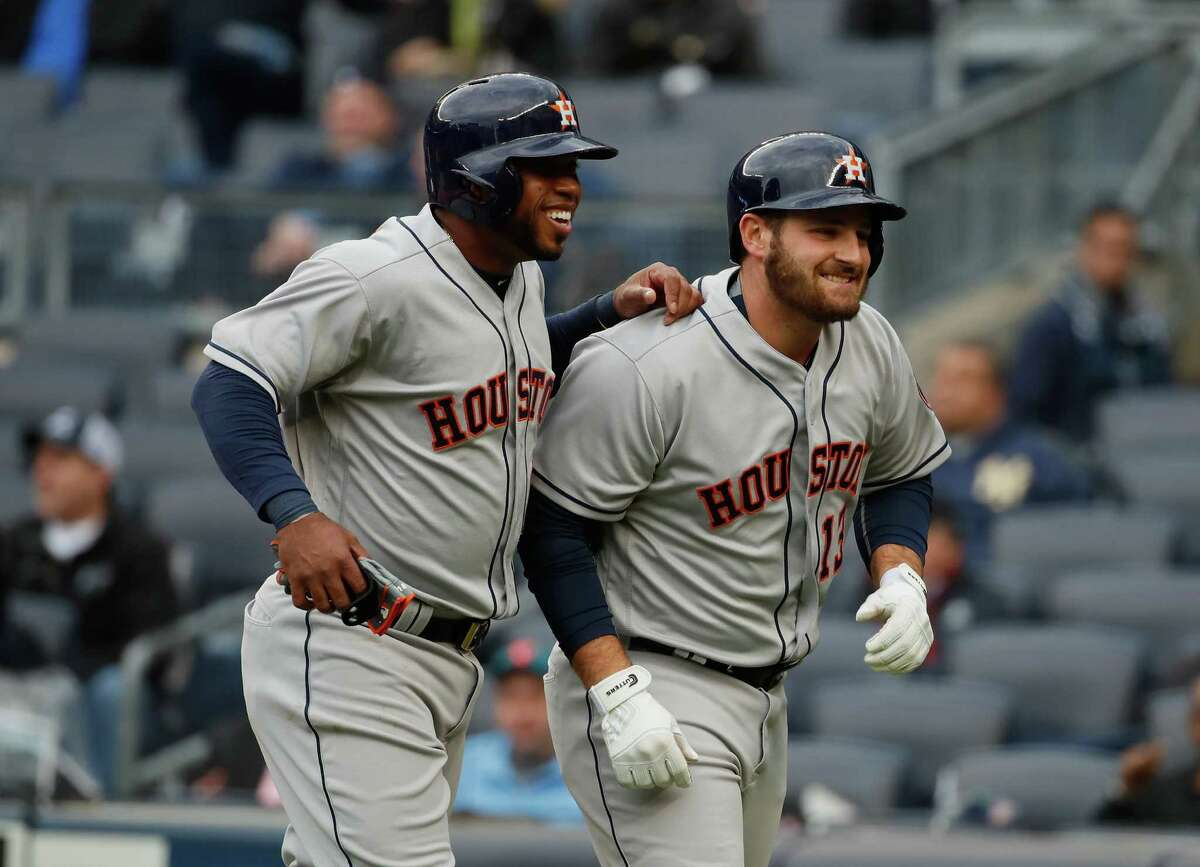 April 7: Yankees 8, Astros 5 NEW YORK, NY - APRIL 07: Tyler White #13 of the Houston Astros celebrates his home run with Luis Valbuena in the first inning against the New York Yankees during their game at Yankee Stadium on April 7, 2016 in New York City.