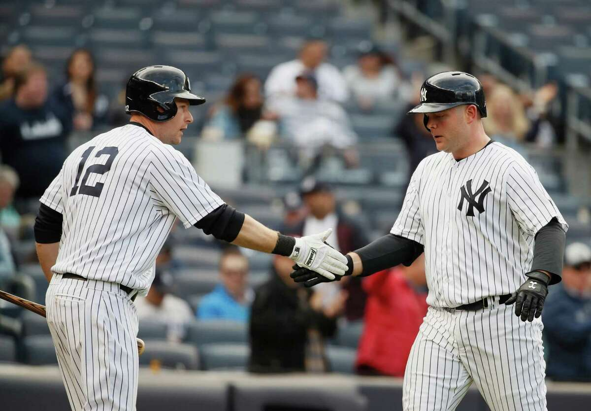 NEW YORK, NY - APRIL 07: Brian McCann #34 of the New York Yankees celebrates his home run with Chase Headley #12 against the Houston Astros in the fourth inning during their game at Yankee Stadium on April 7, 2016 in New York City.