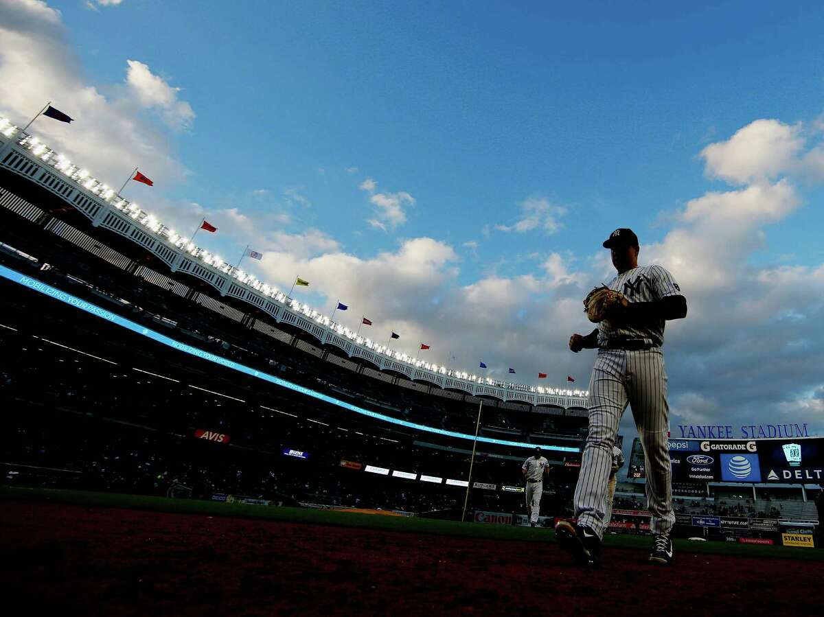 NEW YORK, NY - APRIL 07: Mark Teixeira #25 of the New York Yankees heads back to the dugout between innings against the Houston Astros during their game at Yankee Stadium on April 7, 2016 in New York City.