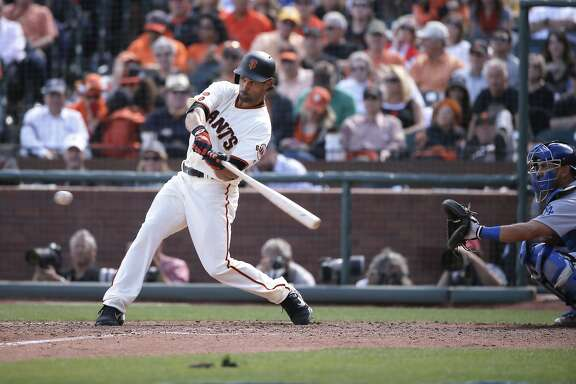 Giants' Angel Pagan, 16 singles to  right in the 6th inning, as the San Francisco Giants take on the Los Angeles Dodgers during their home opener of the 2016 MLB season, at AT&T Park in San Francisco, California on Thurs. April 7, 2016.