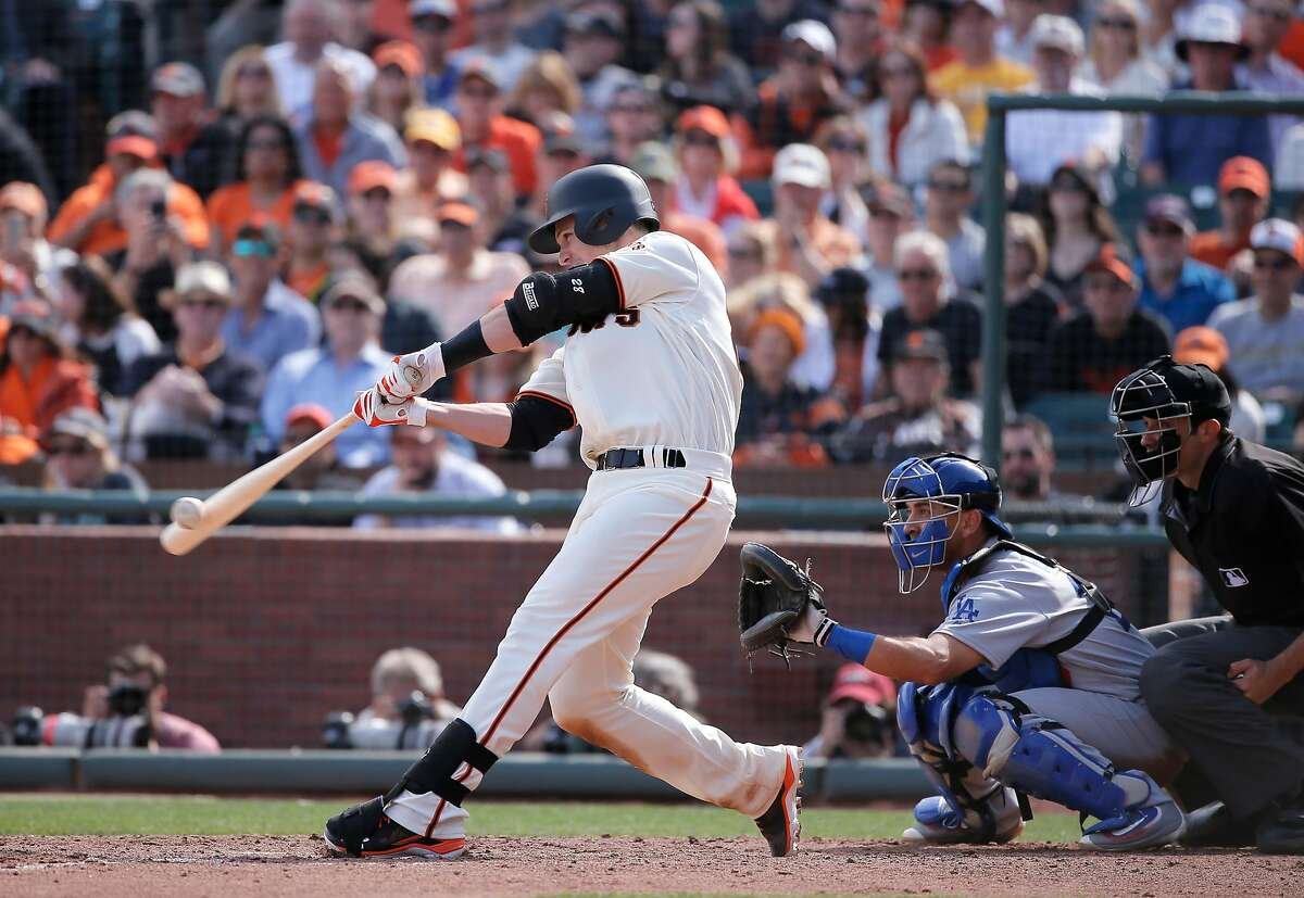 Giants' Buster Posey, 28 doubles in the sixth inning to score JOe Panik, 12 and give the Giants a 7-4 lead, as the San Francisco Giants take on the Los Angeles Dodgers during their home opener of the 2016 MLB season, at AT&T Park in San Francisco, California on Thurs. April 7, 2016.