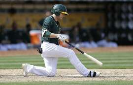 Oakland Athletics' Jed Lowrie strikes out to the Chicago White Sox in the eighth inning of a baseball game Thursday, April 7, 2016, in Oakland, Calif. (AP Photo/Ben Margot)
