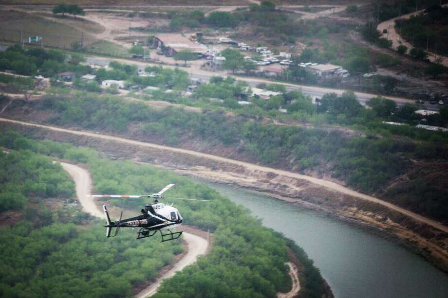Texas Lt. Gov. Dan Patrick rides on a Texas Department of Public Safety helicopter flying over the Rio Grande during a one-day tour to the border on March 8, 2016, in McAllen. ( Marie D. De Jesus / Houston Chronicle ) Photo: Marie D. De Jesus, Staff / © 2016 Houston Chronicle