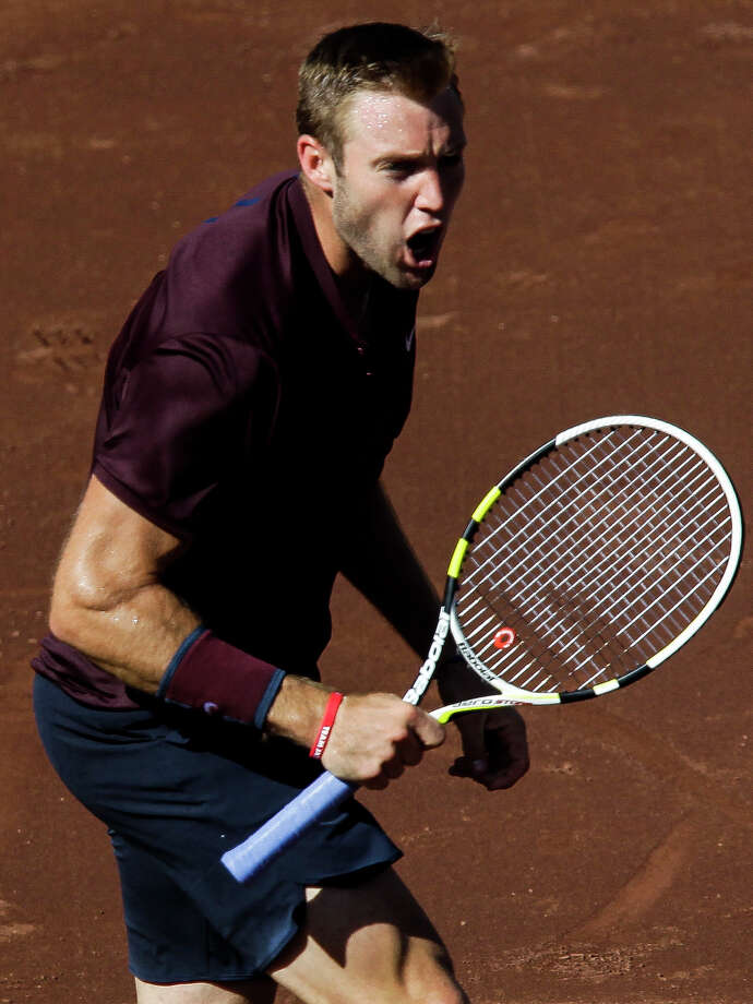 Jack Sock reacts as he scores a point against Matthew Barton during the tie breaker in the second round of the US Men's Clay Court Championship at the River Oaks Country Club Thursday, April 7, 2016 in Houston. Sock beat Barton 6-2, 7-6(5). Photo: Michael Ciaglo, Houston Chronicle / © 2016  Houston Chronicle