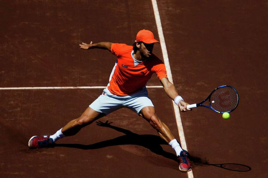 Feliciano Lopez crashes the net to return a ball to Lukas Lacko in the second round of the US Men's Clay Court Championship at the River Oaks Country Club Thursday, April 7, 2016 in Houston. Lopez beat Lacko 7-6(4), 6-1. Photo: Michael Ciaglo, Houston Chronicle / © 2016  Houston Chronicle
