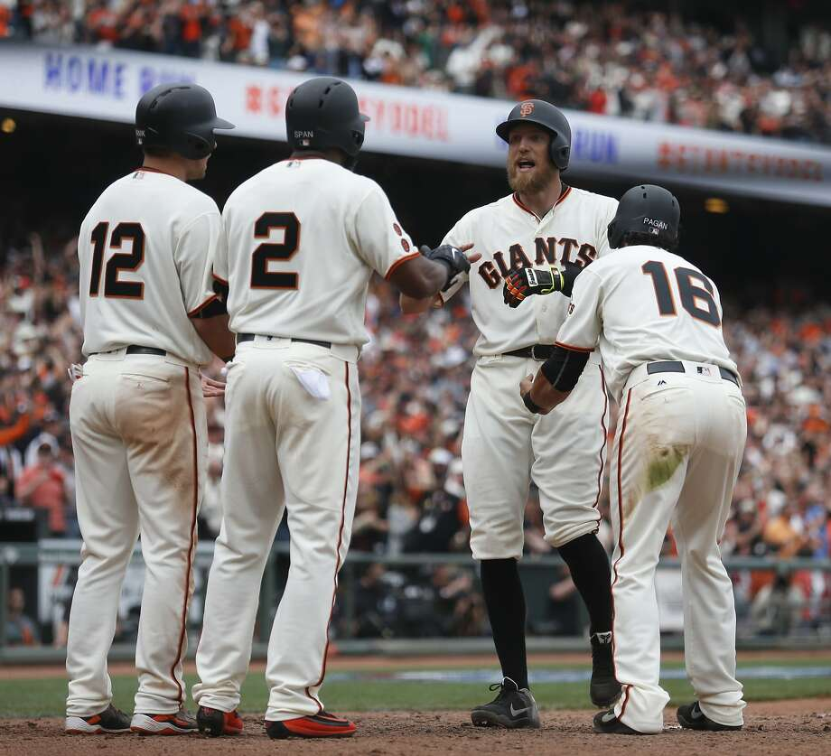 San Francisco Giants' Hunter Pence is congratulated by Joe Panik (12), Denard Span (2) and Angel Pagan (16) after all three scored on a grand slam by Pence during the eighth inning of the home opening day game against the Los Angeles Dodgers on Thursday, April 7, 2016 in San Francisco, Calif. Photo: Beck Diefenbach, Special To The Chronicle