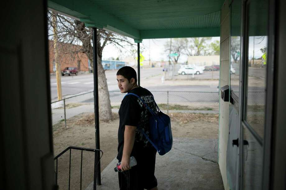 Esai Torres, 14, who describes himself as a baby gangster, was once a member of the Los Carnales East Side Dukes, but has since stepped away from the gang life in fear that he would end up killed. Photo: NICK COTE, STR / NYTNS