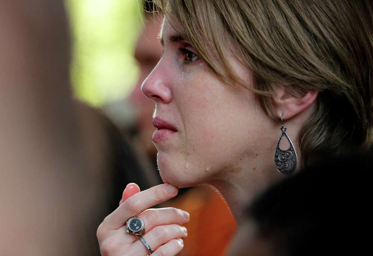 A University of Texas students cries during a gathering for fellow student Haruka Weiser on campus Thursday, April 7, 2016, in Austin, Texas. Weiser, a first-year theater and dance student from Oregon, was found dead on campus after she was reporter missing earlier this week. (AP Photo/Eric Gay)
