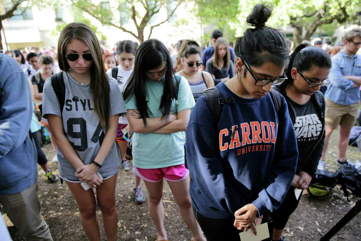 University of Texas students take part in a moment of silence during a gathering for fellow student Haruka Weiser on campus, Thursday, April 7, 2016, in Austin, Texas. Weiser, a first-year dance student from Oregon, was found dead on campus after she was reporter missing earlier this week. (AP Photo/Eric Gay)