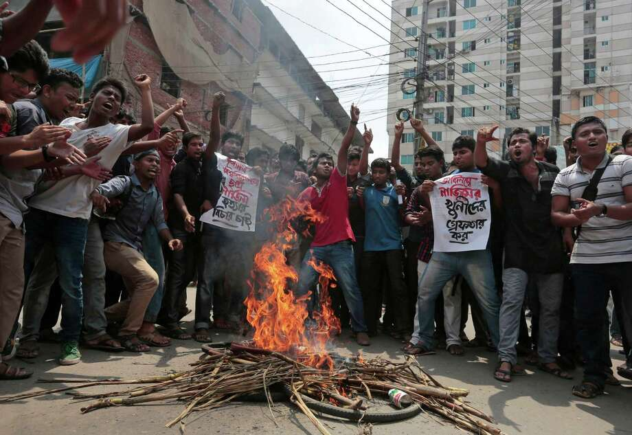 Bangladeshi students protest seeking arrest of three motorcycle-riding assailants who hacked student activist Nazimuddin Samad to death as he walked with a friend, in Dhaka, Bangladesh, Thursday, April 7, 2016. Police suspect 28-year-old Samad was targeted for his outspoken atheism in the Muslim majority country and for supporting a 2013 movement demanding capital punishment for war crimes involving the country's independence war against Pakistan in 1971, according to Dhaka Metropolitan Police Assistant Commissioner Nurul Amin. ( AP Photo) Photo: STR / AP