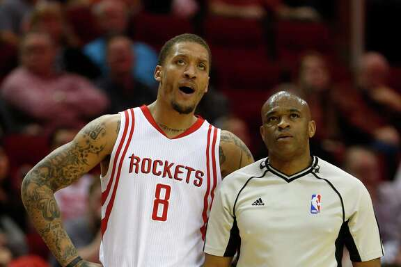 Houston Rockets forward Michael Beasley (8) talks with referee Tre Maddox during the first half of an NBA basketball game at Toyota Center, Thursday, April 7, 2016, in Houston.