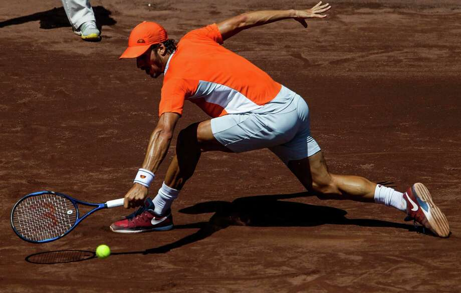 Feliciano Lopez stretches for a return against Lukas Lacko on Thursday in the second round of the U.S. Men's Clay Court Championship at River Oaks Country Club. Lopez beat Lacko 7-6 (4), 6-1. Photo: Michael Ciaglo, Staff / © 2016  Houston Chronicle