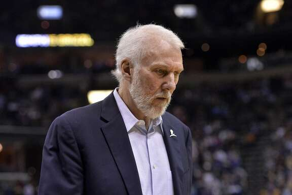 San Antonio Spurs head coach Gregg Popovich walks off the court after the first half of an NBA basketball game Monday, March 28, 2016, in Memphis, Tenn. (AP Photo/Brandon Dill)