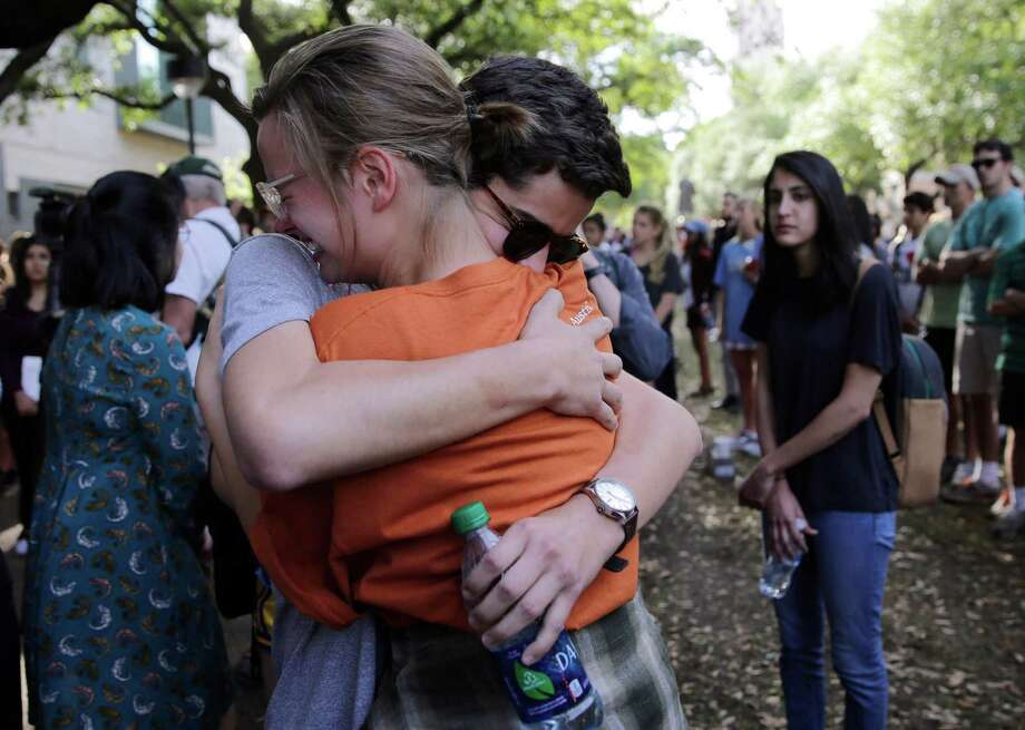 University of Texas students embrace during a gathering for fellow student Haruka Weiser on campus, Thursday, April 7, 2016, in Austin, Texas. Weiser, a first-year theater and dance student from Oregon, was found dead on campus after she was reporter missing earlier this week. (AP Photo/Eric Gay) Photo: Eric Gay, STF / AP / Copyright 2016 The Associated Press. All rights reserved. This material may not be published, broadcast, rewritten or redistribu