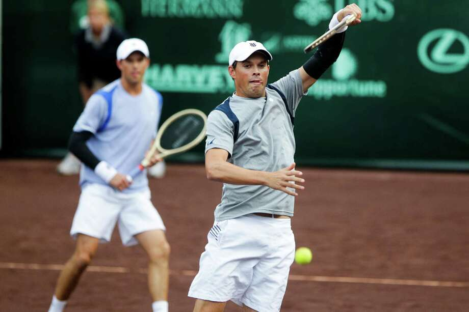 Bob Bryan, right, puts away a winner as he and Mike Bryan beat countrymen Reilly Opelka and Tommy Paul in the second round of the tournament. Photo: Michael Ciaglo, Staff / © 2016  Houston Chronicle