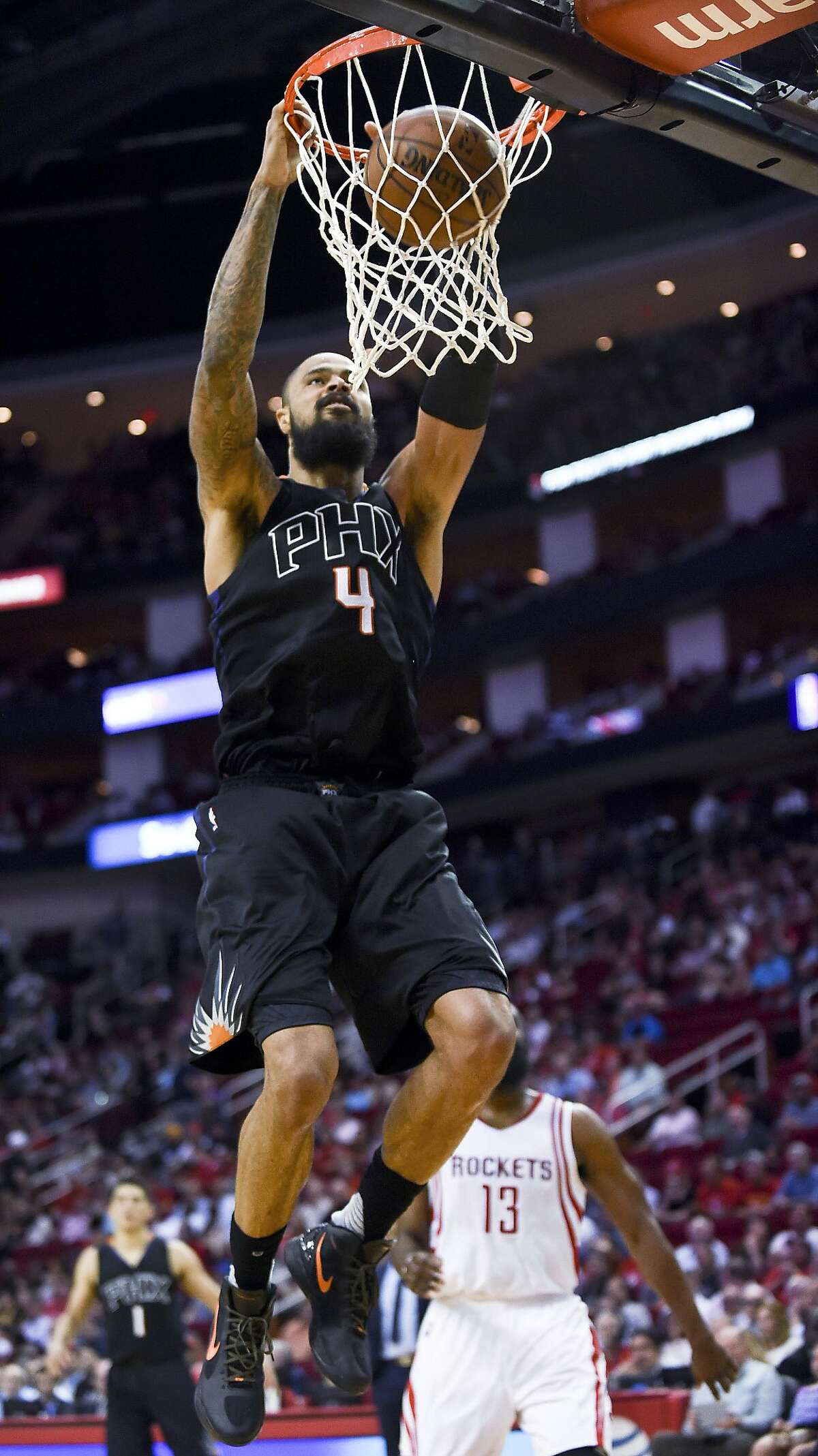 Phoenix Suns center Tyson Chandler dunks during the second half of an NBA basketball game against the Houston Rockets, Thursday, April 7, 2016, in Houston. Phoenix won 124-115. (AP Photo/Eric Christian Smith)
