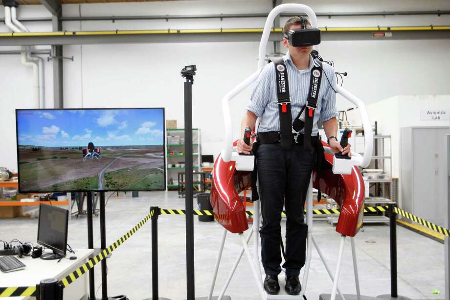 Test pilot Michael van der Vliet operates a flight simulator at the Martin Aircraft Co. headquarters in Christchurch, New Zealand. The jet pack is meant for first responders such as firefighters. Photo: Nick Perry, STF / AP