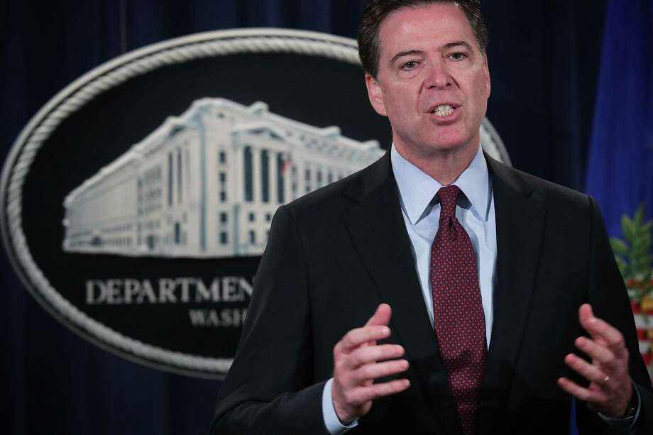 WASHINGTON, DC - MARCH 24:  FBI Director James Comey speaks during a news conference for announcing a law enforcement action March 24, 2016 in Washington, DC. A grand jury in the Southern District of New York has indicted seven Iranian who were employed by two Iran-based computer companies that performed work on behalf of the Iranian Government, on computer hacking charges related to their involvement in an extensive campaign of over 176 days of distributed denial of service (DDoS) attacks.  (Photo by Alex Wong/Getty Images) Photo: Alex Wong, Staff / 2016 Getty Images