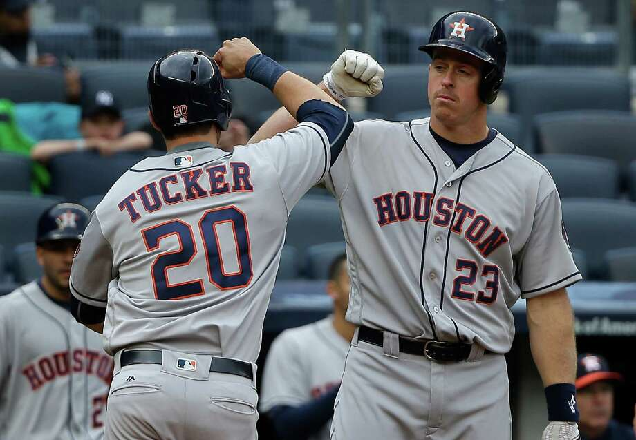 Astros outfielder Preston Tucker is greeted by teammate Erik Kratz after hitting a solo homer in the second inning of Thursday's loss at Yankee Stadium. Photo: Julie Jacobson, STF / Copyright 2016 The Associated Press. All rights reserved. This material may not be published, broadcast, rewritten or redistribu