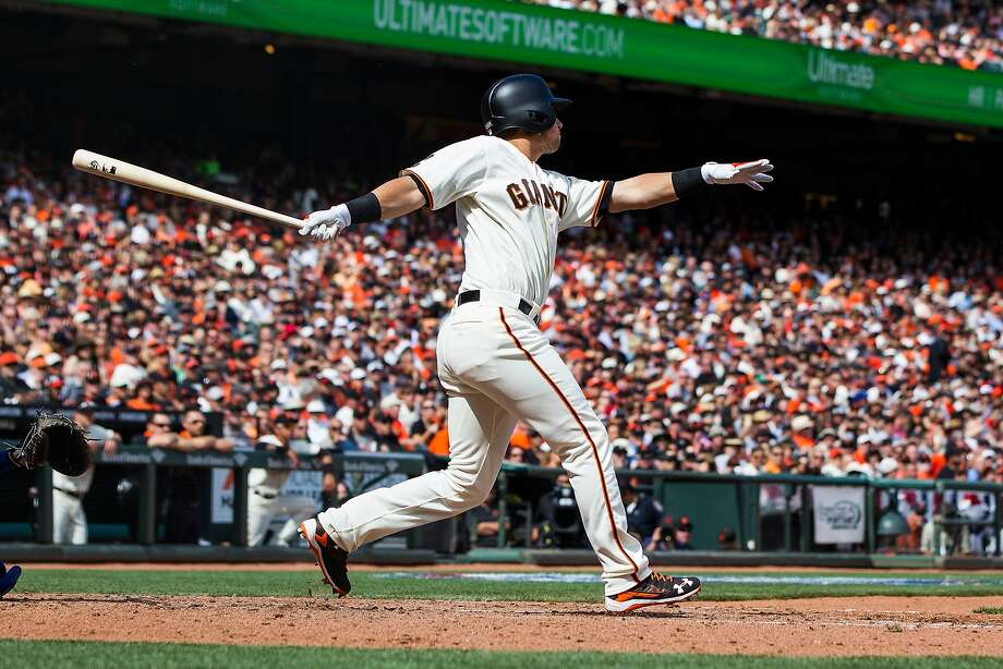 Second baseman Joe Panik rips an RBI triple in the fifth inning, the first of his three run-scoring hits in the victory over the Dodgers. Photo: Jason O. Watson, Getty Images