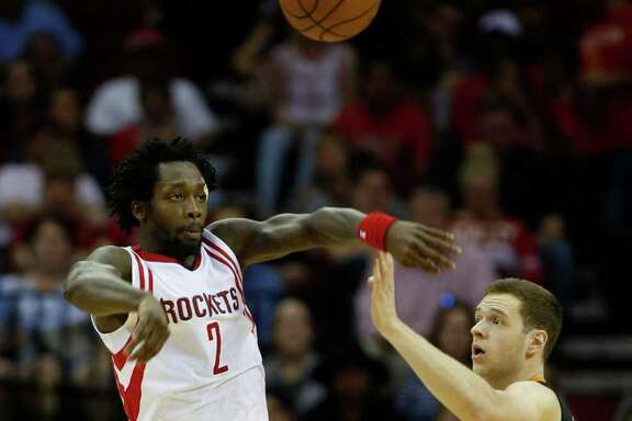 Rockets guard Pat Beverley (2) passes the ball over  Suns forward Jon Leuer (30) during the first half. Beverley had nine assists on the night.