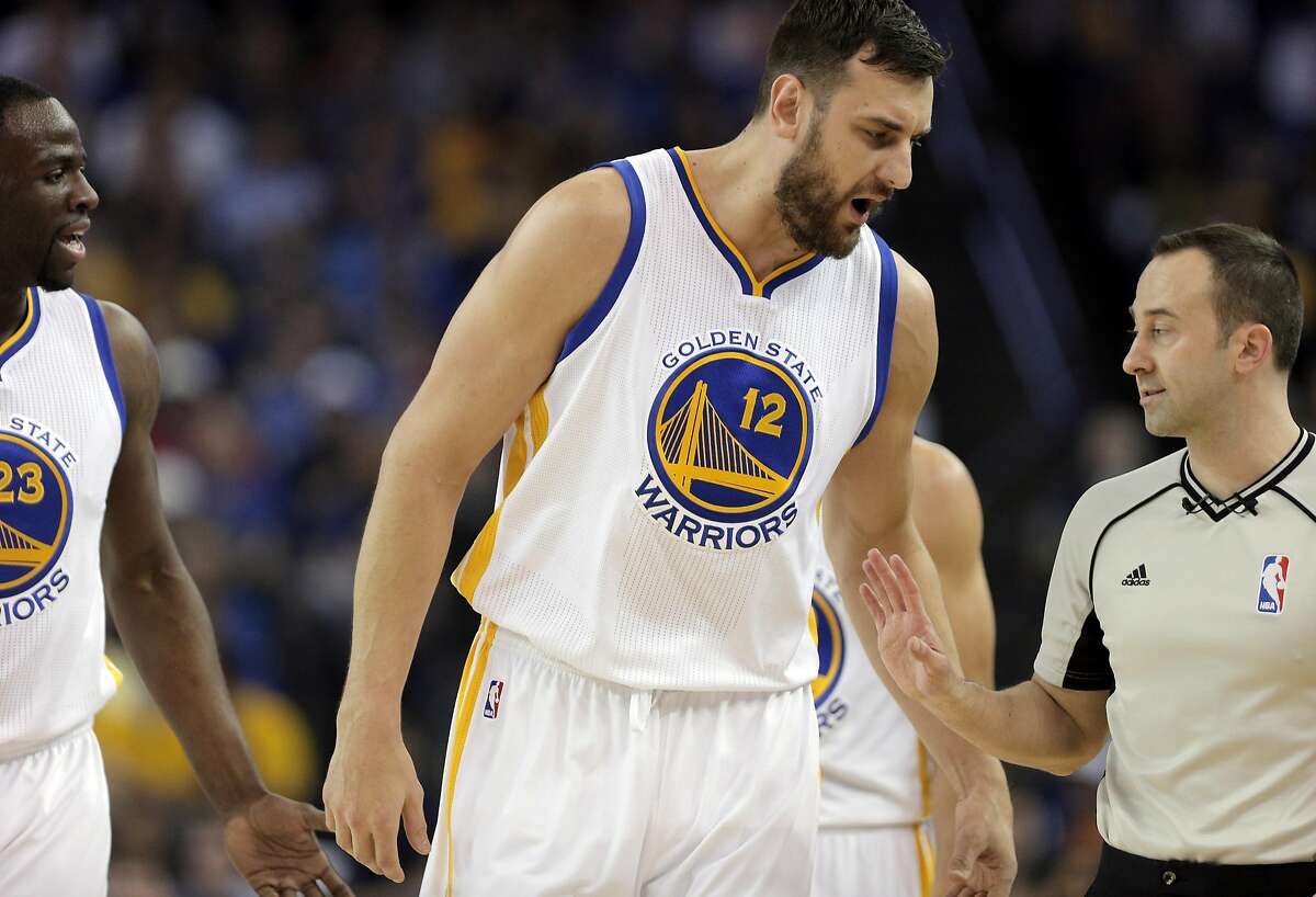 Draymond Green (23) and Andrew Bogut (12) discuss a foul call with a referree during the first half as the Golden State Warriors played the San Antonio Spurs at Oracle Arena in Oakland Calif., on Thursday, April 7, 2016.