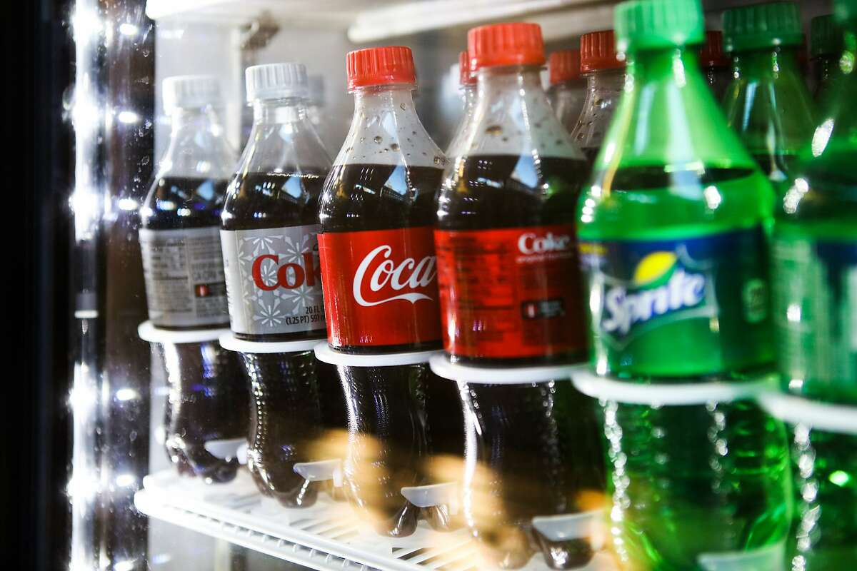 Bottles of soda sit in a refrigerator at a cafe on San Francisco State University's campus in San Francisco, California on Thursday, November 12, 2015.