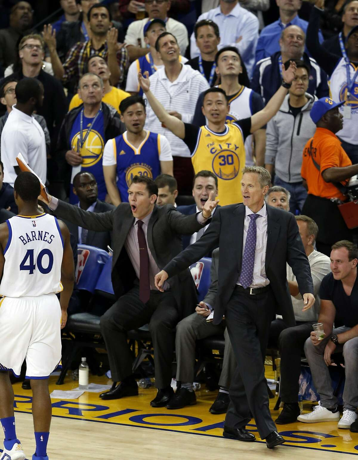 Golden State Warriors' head coach Steve Kerr and assistant coach Luke Walton react to a foul call in 3rd quarter while playing San Antonio Spurs during NBA game at Oracle Arena in Oakland, Calif., on Thursday, April 7, 2016.