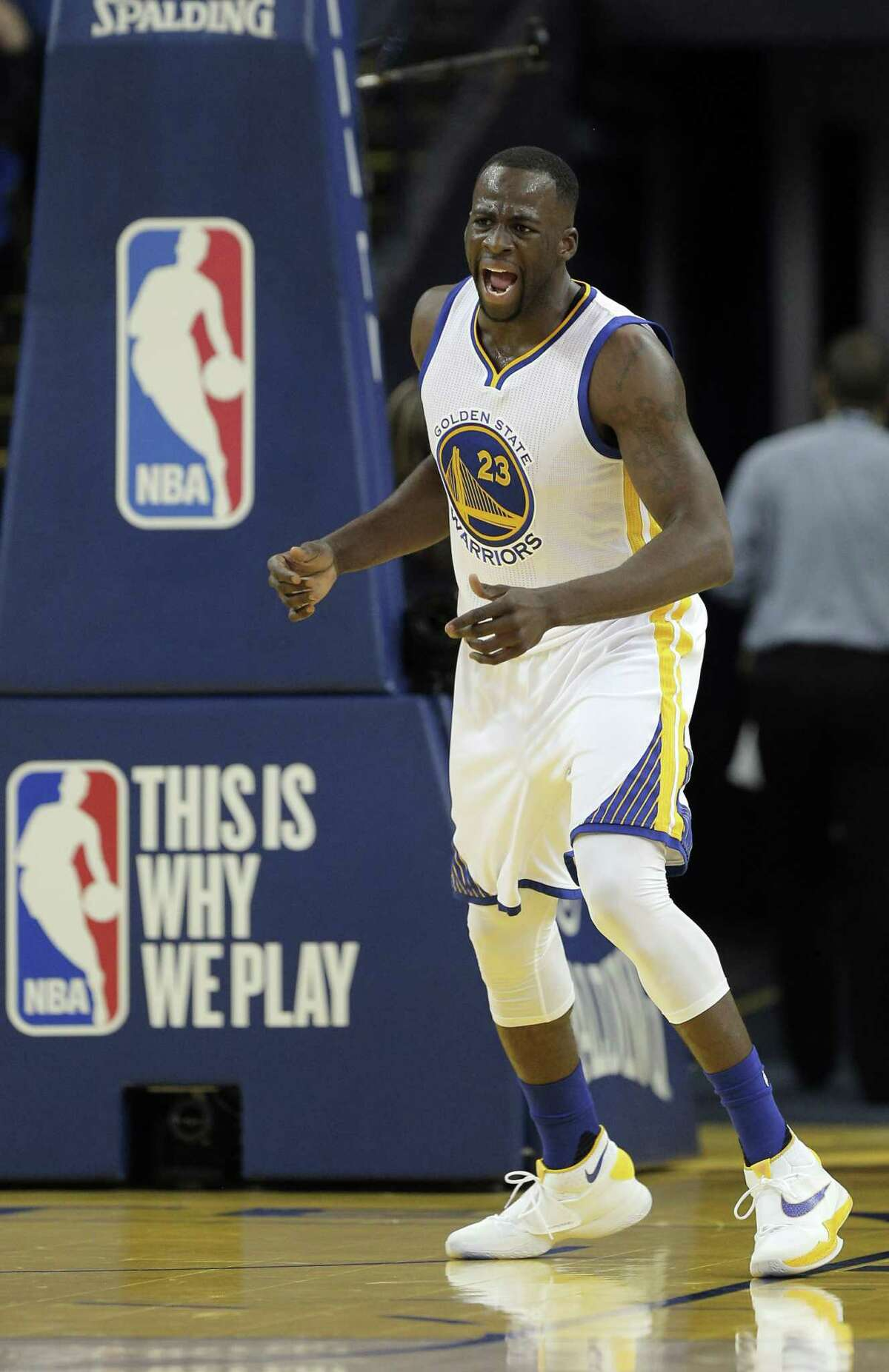 Draymond Green (23) reacts after dunking the ball during the first half as the Golden State Warriors played the San Antonio Spurs at Oracle Arena in Oakland Calif., on Thursday, April 7, 2016.
