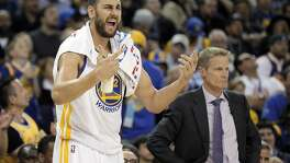 Andrew Bogut (12) reacts to a call against the Warriors during the second half as the Golden State Warriors played the San Antonio Spurs at Oracle Arena in Oakland Calif., on Thursday, April 7, 2016.