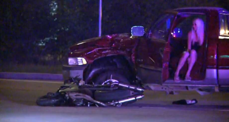 FM 1960 near U.S. 59 is shut down in both directions early Friday morning after a motorcyclist died when he slammed into a pickup as he sped away from police in north Houston. Photo: Metro Video Screen Shot