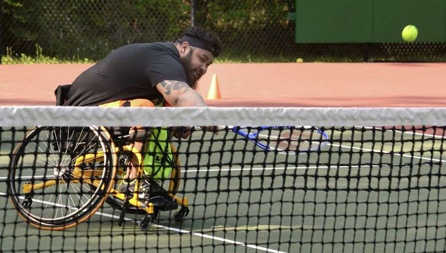 Brian Stringer of The Woodlands stretches for a return during on of the weekly practice sessions for the Spring Rollers wheelchair tennis team at Ridgewood Park. Photo: Z-David Hopper