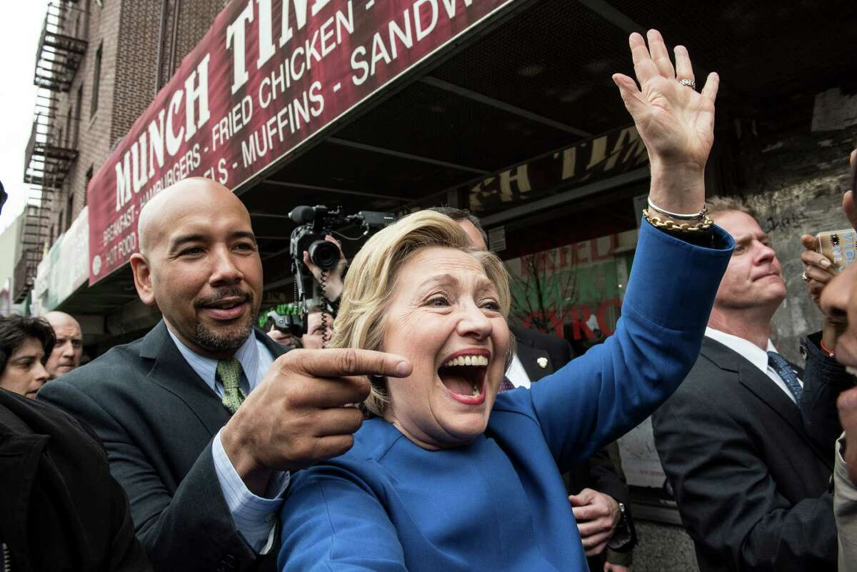 Democratic presidential candidate Hillary Clinton campaigns with borough President Ruben Diaz Jr. on April 7, 2016 in the Bronx borough of New York City. The former U.S. secretary of state first spoke outside of Yankee Stadium before riding the subway from the 161st Street station to the 170th Street station.