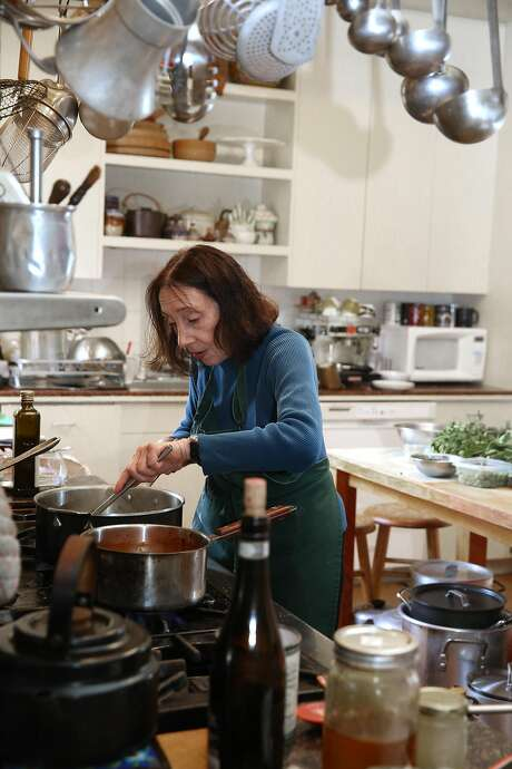 Joyce Goldstein makes artichokes and a fish dish at her S.F. home. Photo: Liz Hafalia, The Chronicle